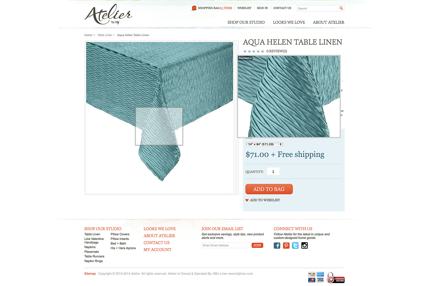 a screen capture of the atelier by bbj aqua helen table linen product page, featuring live zoom functionality as the mouse hovers over the large product image
