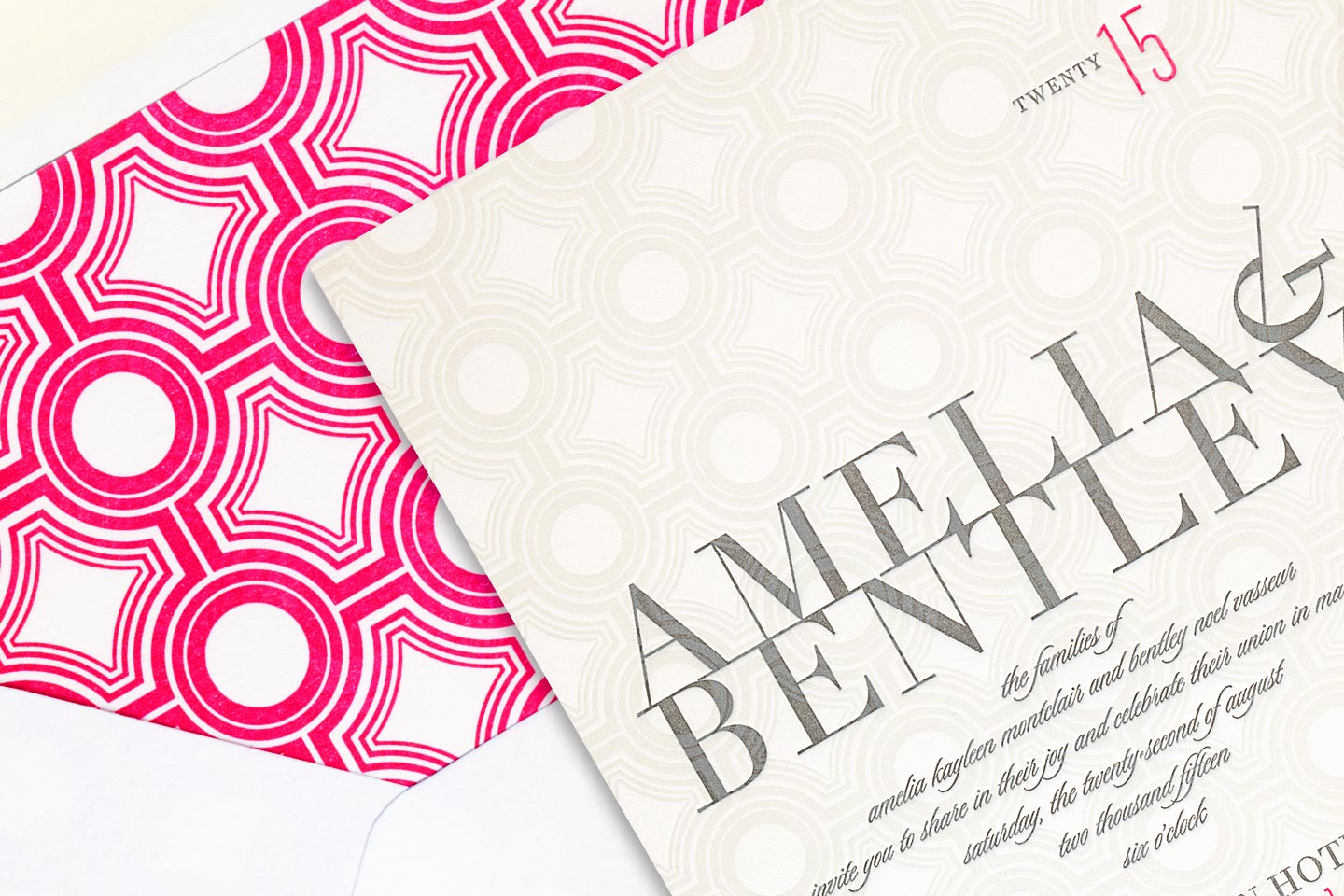a beautiful sample wedding invitation for amelia and bentley, overlayed on top of its envelope featuring a beautiful hot pink liner, captured by 4d, inc