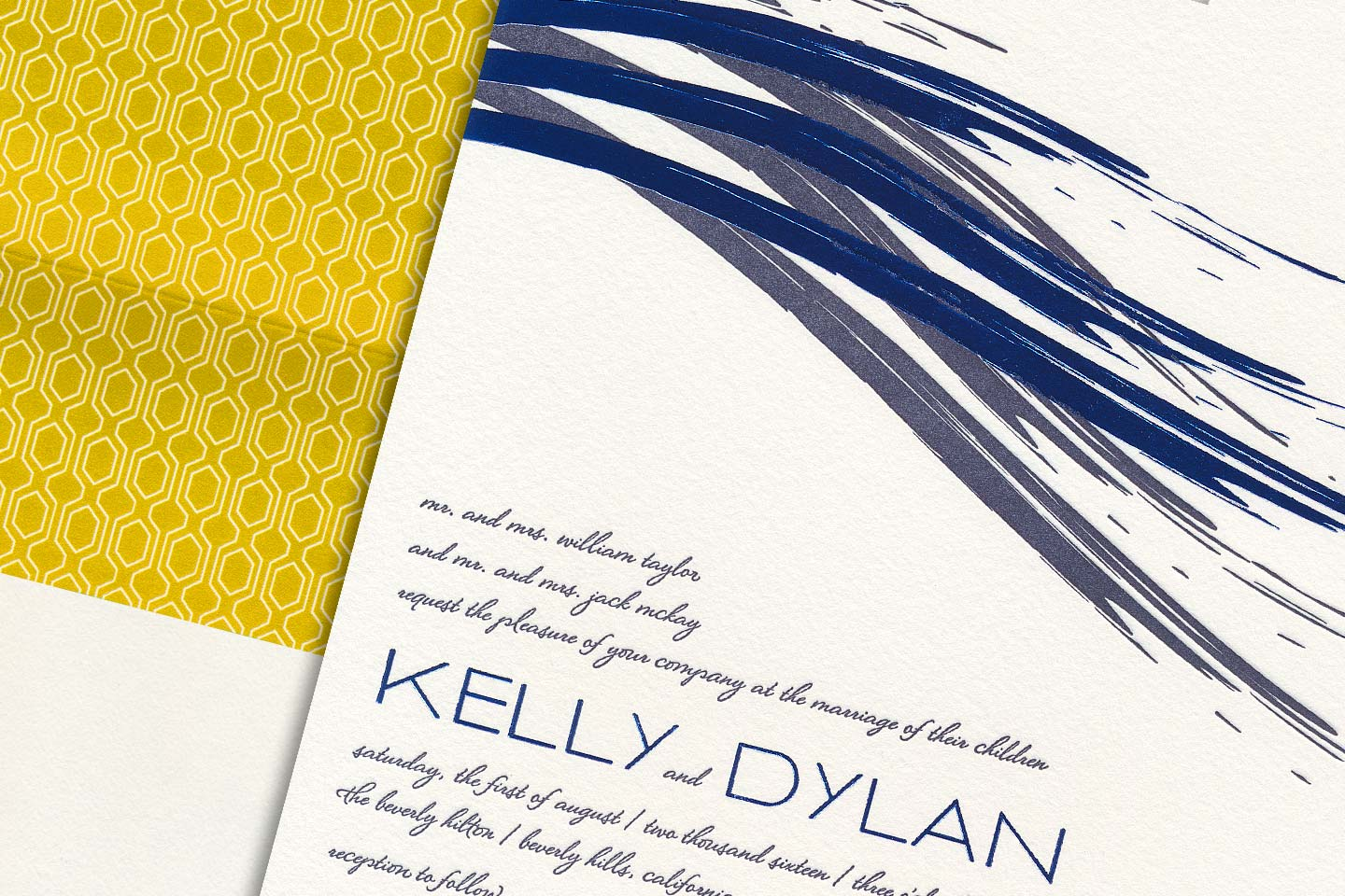 a beautiful sample wedding invitation for kelly and dylan, overlayed on top of its envelope featuring a beautiful floral print liner, captured by 4d, inc