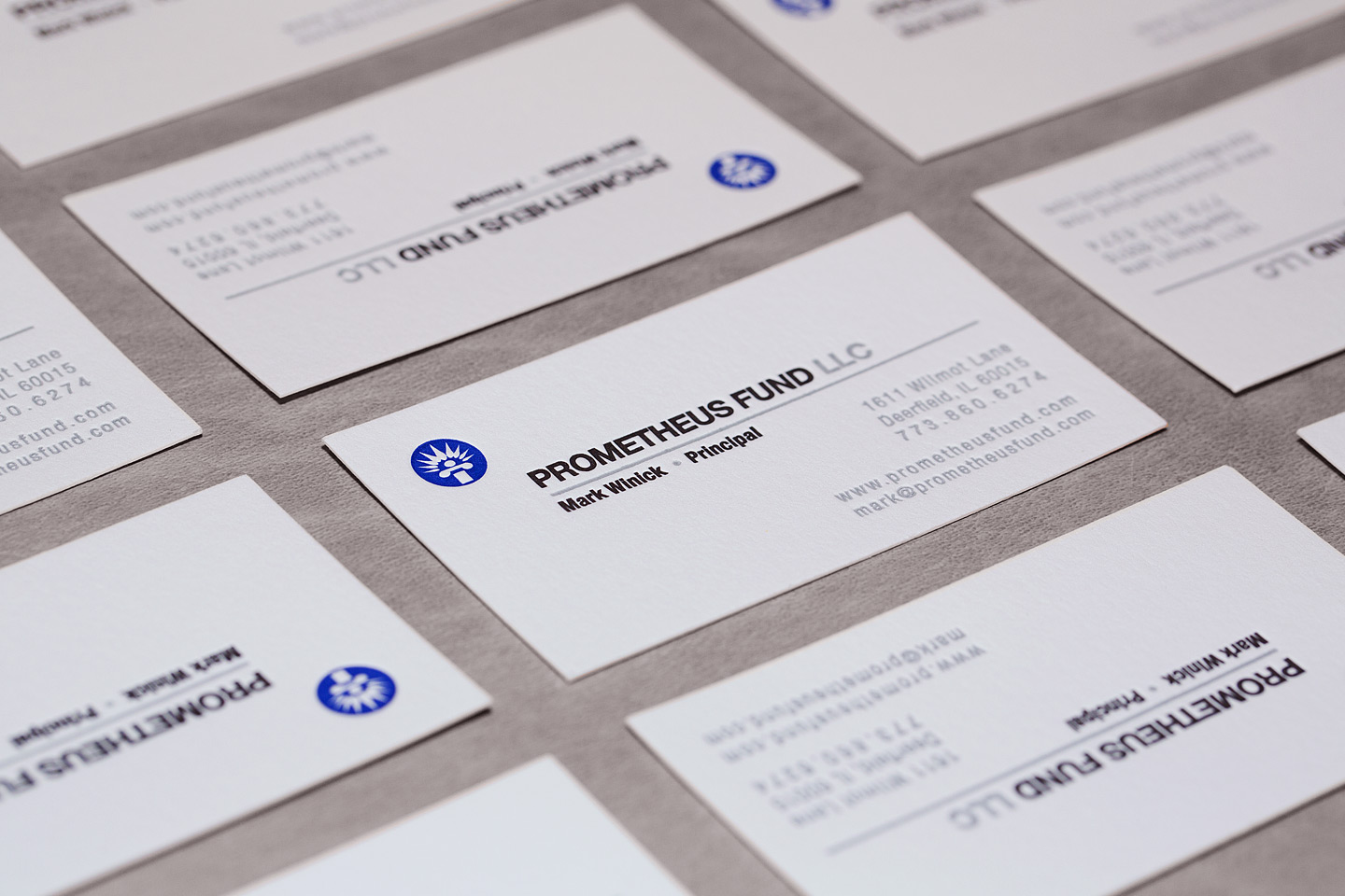 a bunch of prometheus fund llc letterpress business cards laid out in a grid
