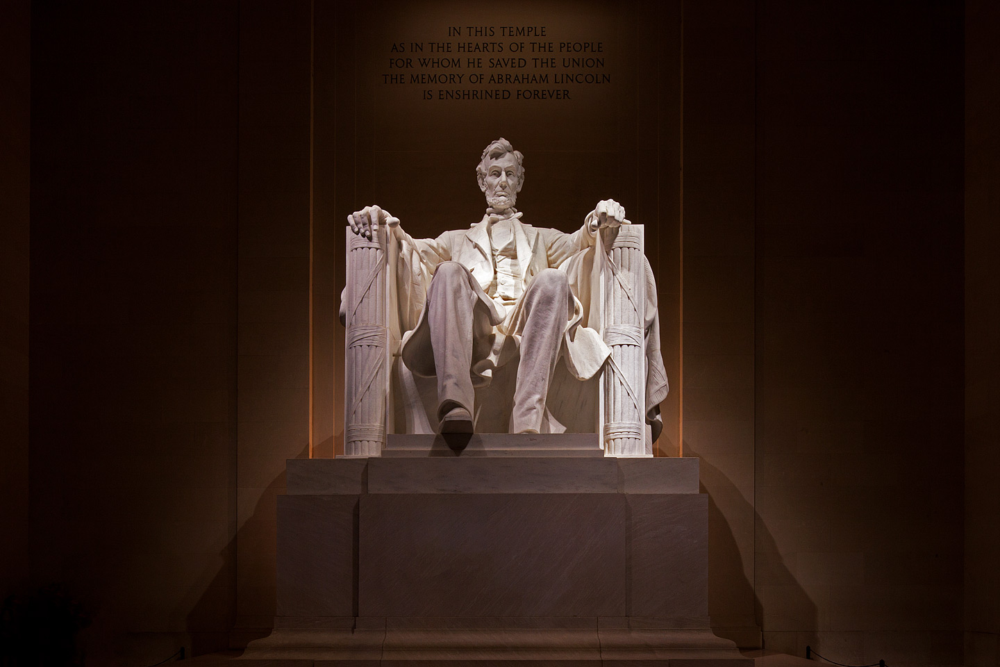 a massive sculpture of abraham lincoln at the lincoln memorial in washington dc photographed at night by Jacob Rosenfeld