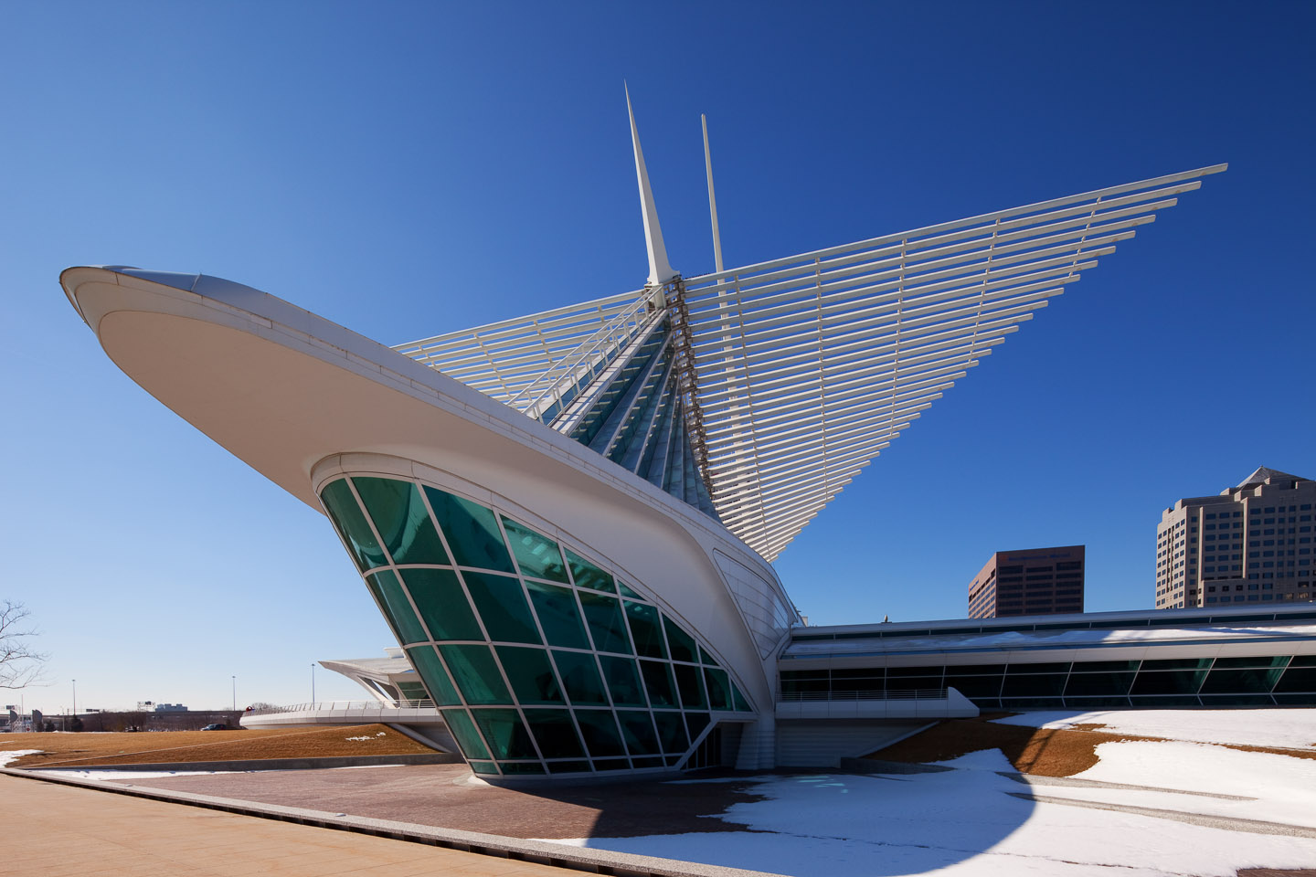 an exterior rear perspective of the Milwaukee Art Museum, designed by Santiago Calatrava, photographed by Jacob Rosenfeld