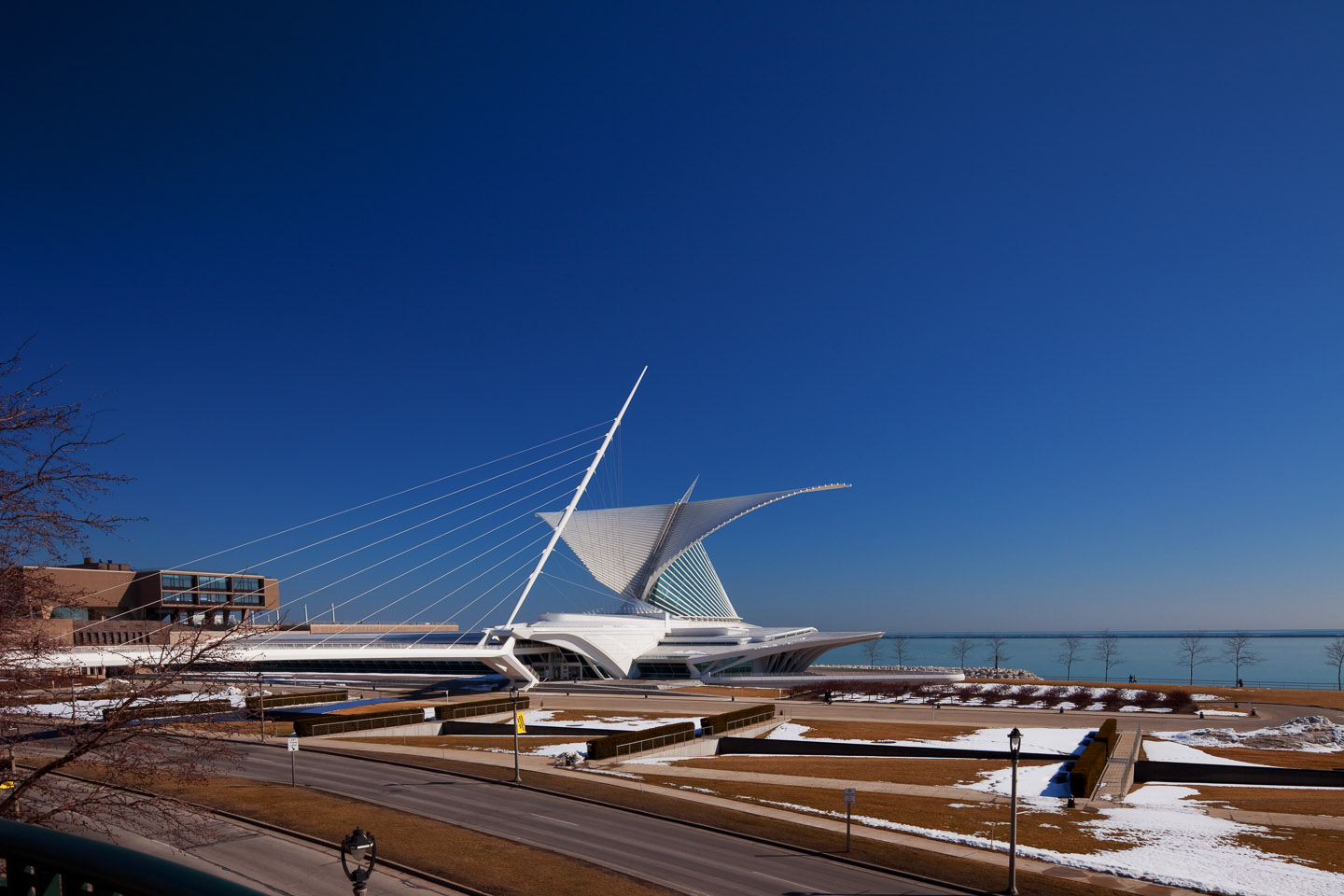 an exterior front corner perspective of the Milwaukee Art Museum, designed by Santiago Calatrava, photographed by Jacob Rosenfeld