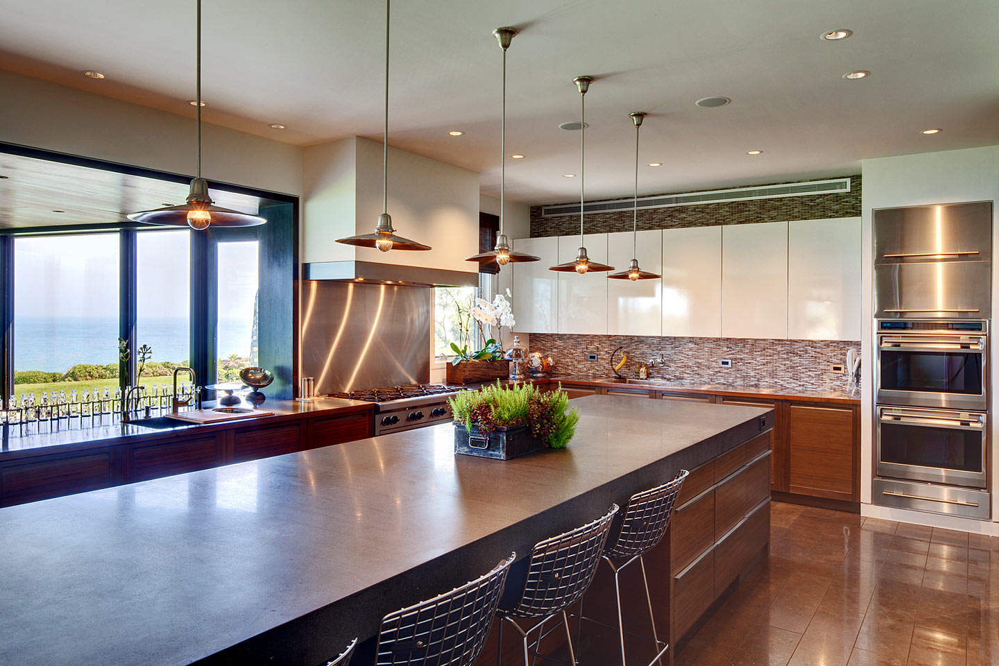 a perspective view (angle 01) of a modern professional kitchen, featuring views of Lake Michigan, photographed by Jacob Rosenfeld