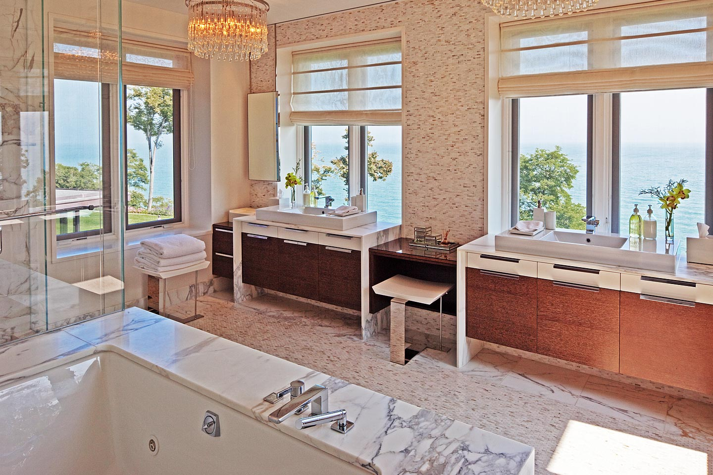 a large modern master bath, featuring an abundance of natural light and views of Lake Michigan, photographed by Jacob Rosenfeld