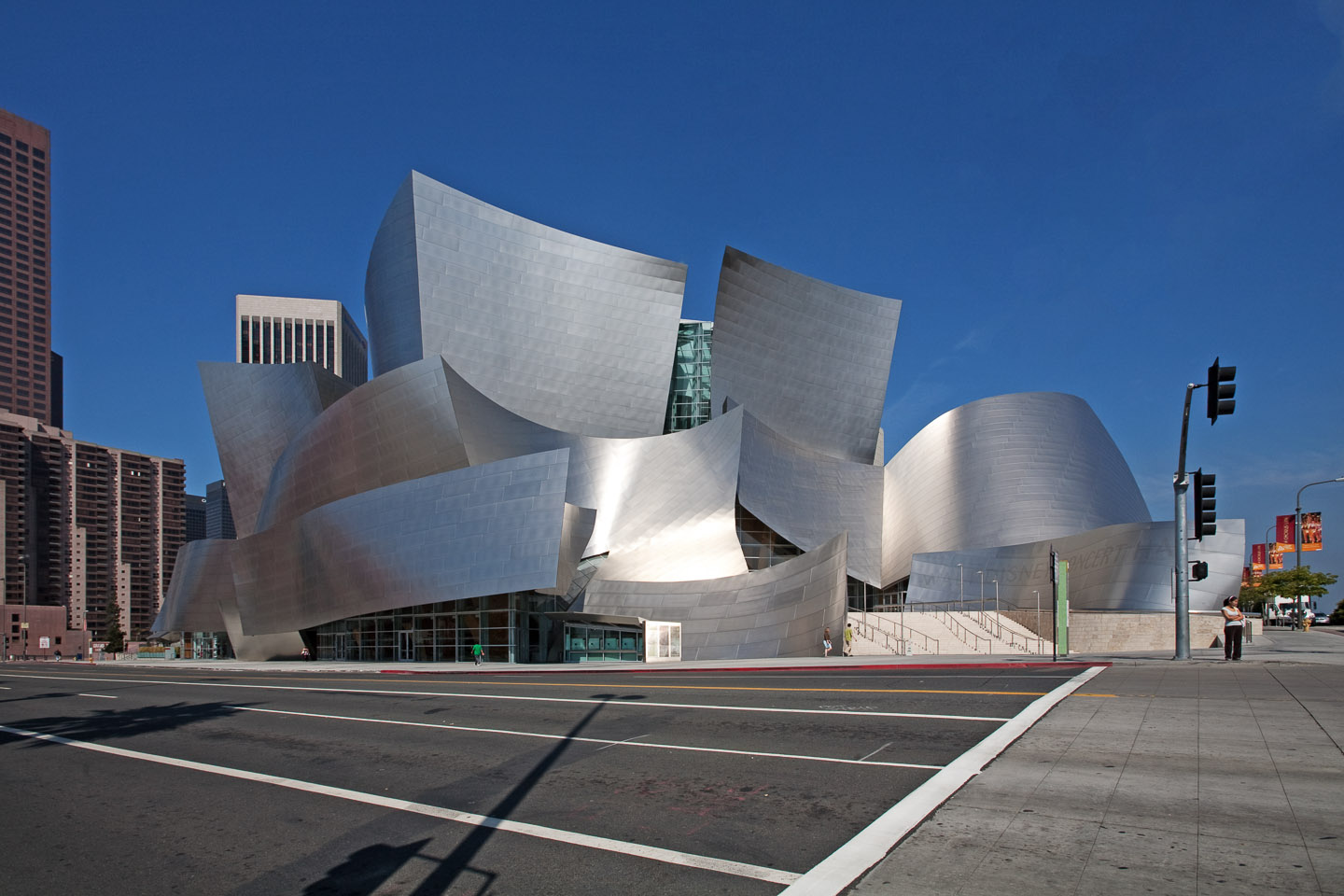 a street view of the Walt Disney Concert Hall, designed by Frank Gehry, located in Los Angeles, photographed by Jacob Rosenfeld
