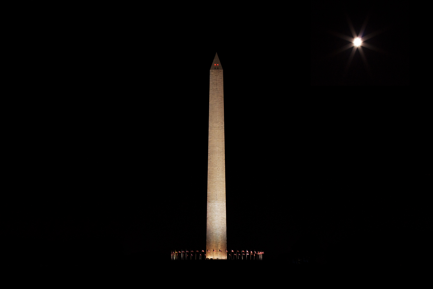 washington monument sitting below a full moon over washington dc photographed by Jacob Rosenfeld