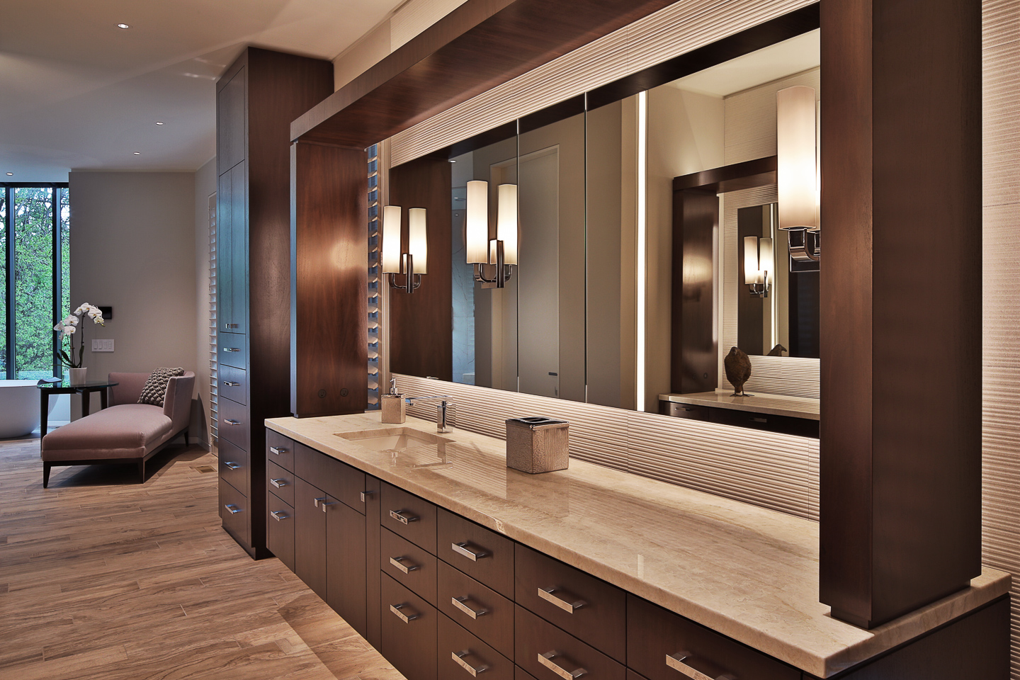 his modern master bath floating vanity featuring dark wood, granite, and polished chrome fixtures, photographed by Jacob Rosenfeld