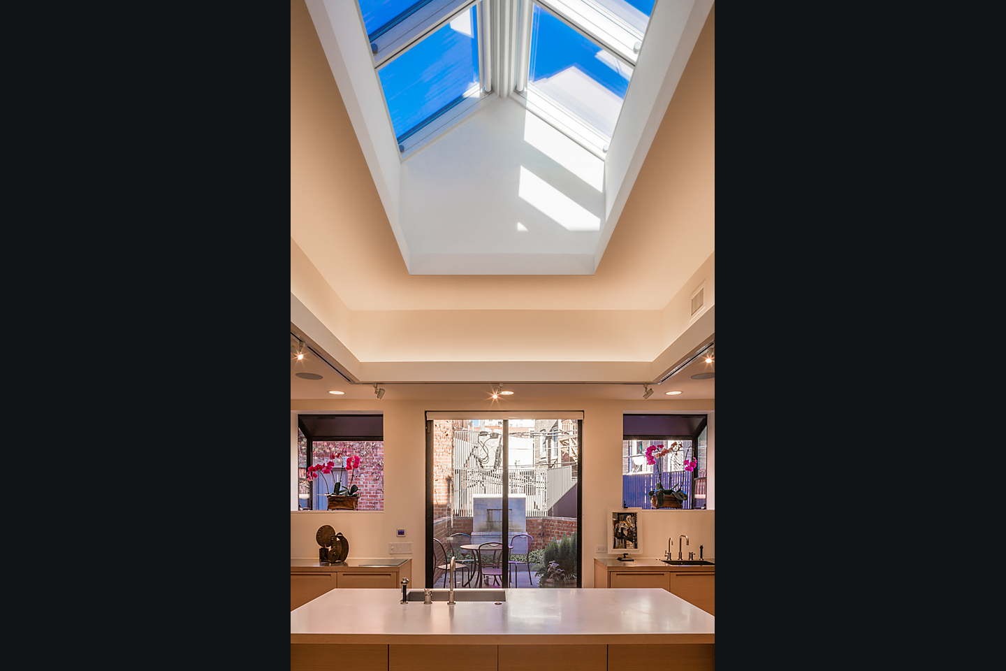luxury kitchen remodel featuring massive commercial skylight, photographed by Jacob Rosenfeld Photography